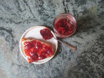 Description: strawberry jam on toast, jar of strawberry jam