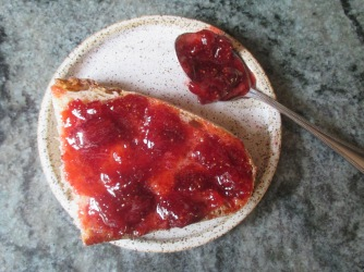 Description: strawberry jam on toast and spoon