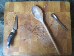 cutting board with spoons, knife